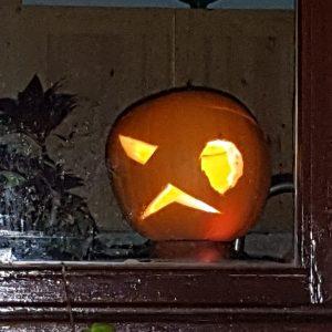 Cambridge Ghost Walks: Halloween pumpkin in a window